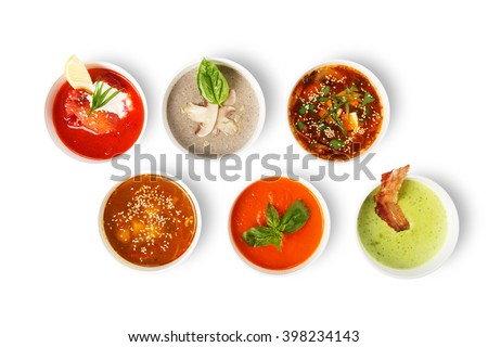Variety of restaurant hot dishes, healthy food. Japanese miso, asian fish soup, russian borscht, english pea soup, mushroom soup, spanish gazpacho isolated at white. Top view, flat lay.
