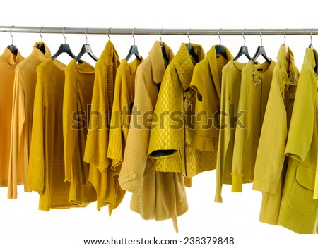 Variety of row female yellow clothing on display  - stock photo
