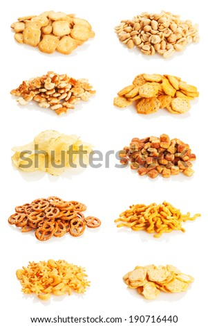 Variety of salty snacks isolated on white background - stock photo