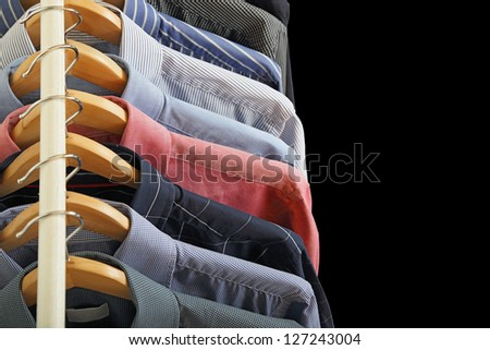 variety of shirts on hangers - stock photo
