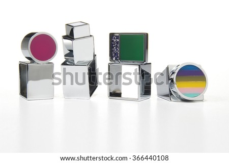 Variety of silver rings on white background