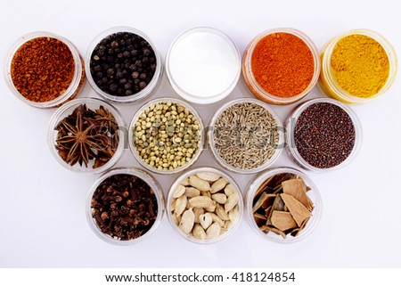 Variety of spices in plastic containers