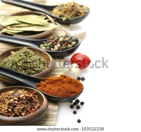 Variety Of Spices In Spoons And Bowls - stock photo