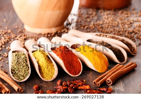 Variety of spices on kitchen table. - stock photo