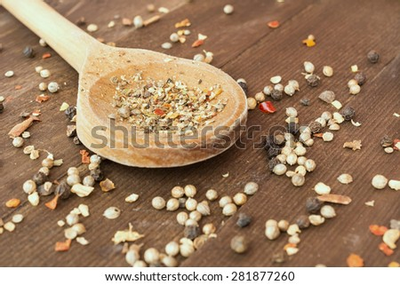 Variety of spices on wooden spoon, ingredients for masala, Indian spice mix  - stock photo