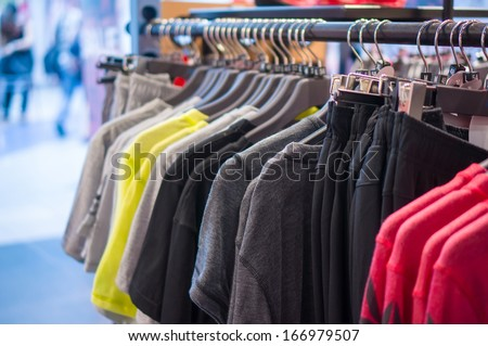 Variety of Sport t-shirts and trousers  on stand in store
