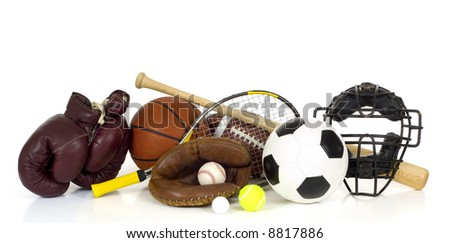 Variety of sports equipment on white background with copy space, items inlcude boxing gloves, a basketball, a soccer ball, a football, - stock photo