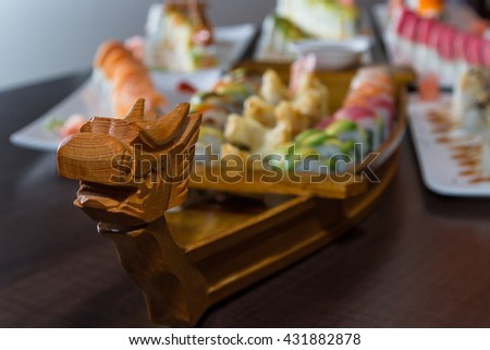 variety of sushi rolls served on a wooden boat