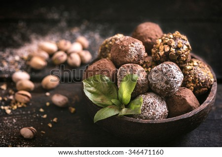 Variety of sweet homemade chocolate pralines on wooden background,selective focus  - stock photo