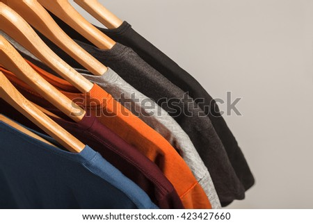Variety of t-shirts. Top view shot with empty space - stock photo