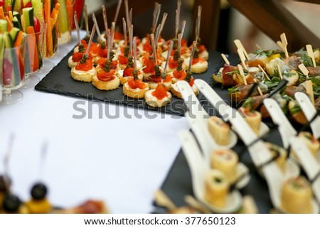 Variety of tasty delicious snacks on the rich wedding table
