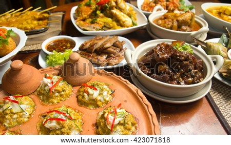 Variety of Thai foods on table (selective focus)