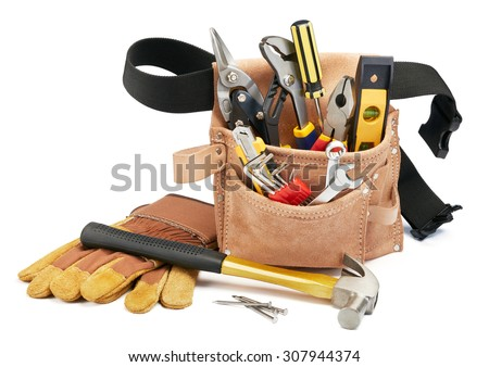 variety of tools with tool belt on white background - stock photo