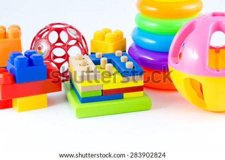 variety of toys on white background