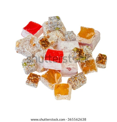 Variety of Turkish Delight with pistachios, walnut, figs and rose and powdered sugar and coconut isolated on white background - stock photo