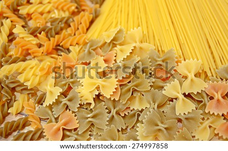 Variety of types and shapes of Italian pasta. Dry pasta background - stock photo