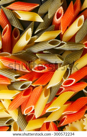 Variety of types and shapes of Italian pasta on black table - stock photo