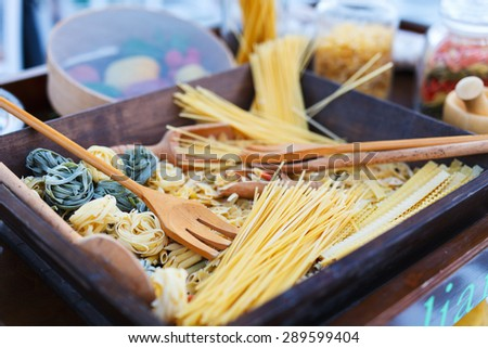 Variety of types and shapes of uncooked  Italian pasta - stock photo