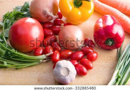 variety of vegetables from fields on table from farmers - stock photo