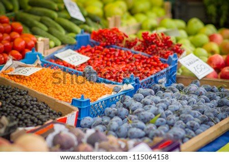 Variety of wild berries on table on city market - stock photo