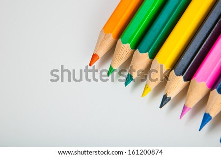 Variety of wooden color pencils isolated on white background