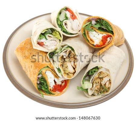 Variety of wrap sandwiches filled with chicken and cheese. - stock photo