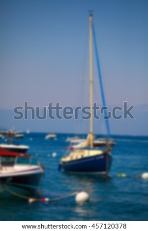 Variety of yacht sailing boat docked with blur applied to image. - stock photo