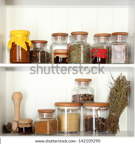 Variety spices on kitchen shelves - stock photo