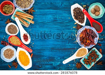 Various asian spices  on a blue wooden background. Top view - stock photo