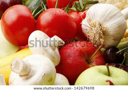 Various, assorted fruits and vegetables( apple, garlic, mushrooms, cauliflower, corn, maize, tomato, cherry, zucchini, green apple). Vibrant color.