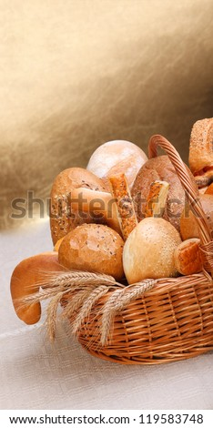 Various bakery products in basket, copy space above