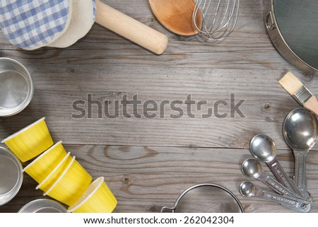 Various baking tools arrange from overhead view on wooden table in vintage tone. Copy space on middle. - stock photo