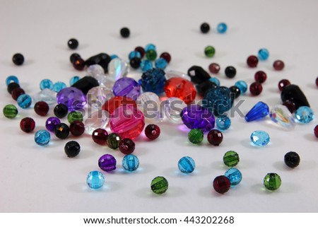 Various beads on white background - stock photo
