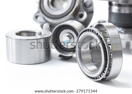 various bearings lie on a gray background - stock photo