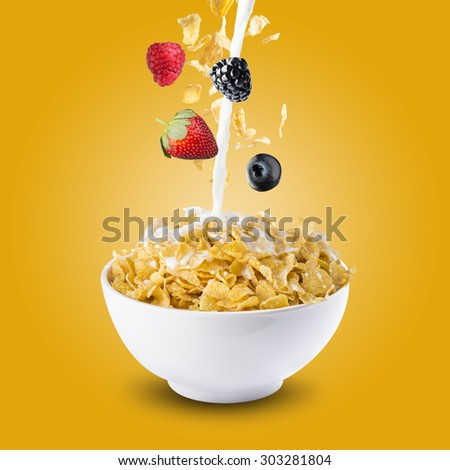 Various Berries Falling Into Bowl of Cereal With Milk Splash