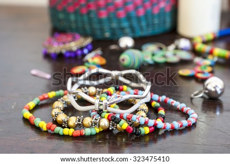 Various bracelets colorful plastic beads. Costume jewelry for  woman - stock photo