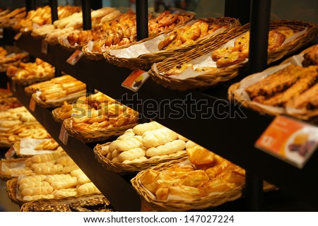 Various bread type on shelf in Bakery shop. - stock photo