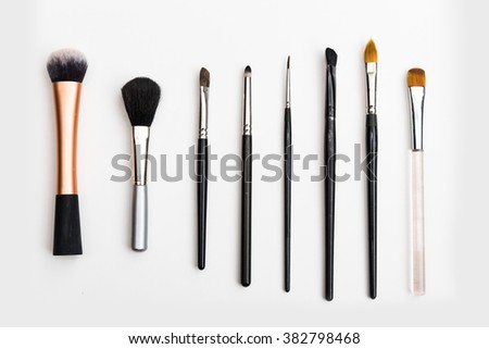 Various brushes for make up and art on white - stock photo