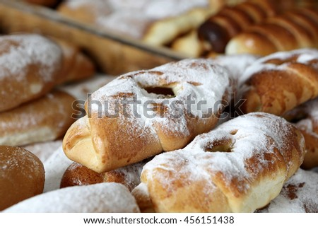 Various cakes on counter of outdoor market - stock photo