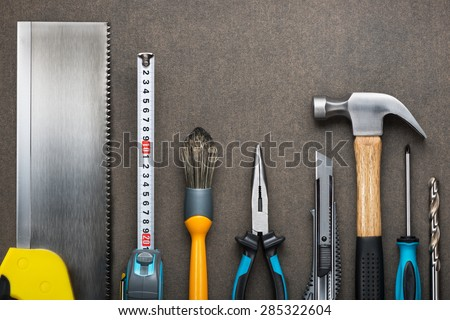Various carpentry, construction tools on the board. - stock photo