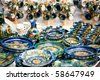 Various ceramic traditional pottery lined up for sale. - stock photo
