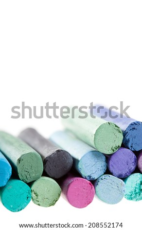 Various chalk pastels isolated on white background, with place for text, shallow dof - stock photo