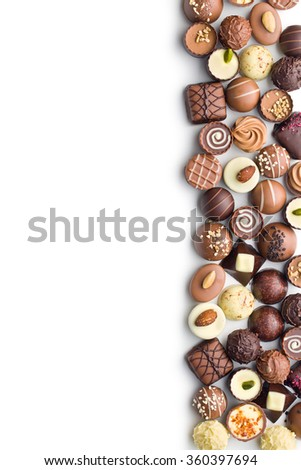 various chocolate pralines on white background