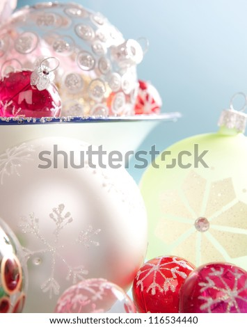 Various Christmas bar balls ornaments in different sizes and colors isolated against a blue background. - stock photo