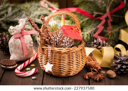 Various Christmas treats and decorations on the table - stock photo