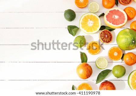 Various citrus fruits on the table - stock photo