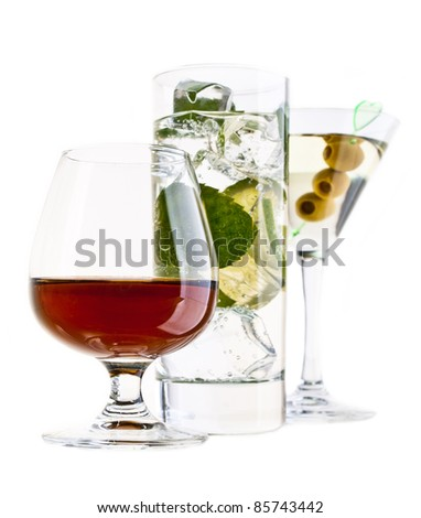 Various cocktails and alcohol on white background
