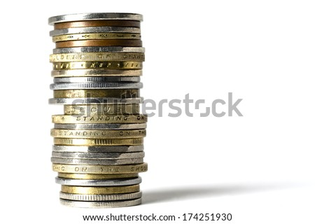 Various coins of different colors, of different sizes  arranged in stack - stock photo