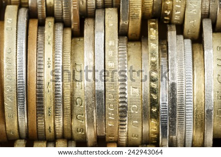 Various coins shown up close, forms the backdrop