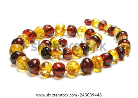 Various color amber necklace in spiral with clipping path - stock photo